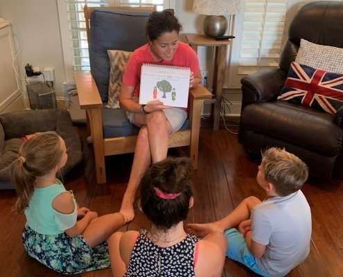 mom teaching the catechism to children at home