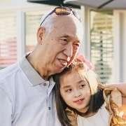 grandfather hugging young girl