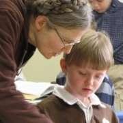teacher making sure each child understands